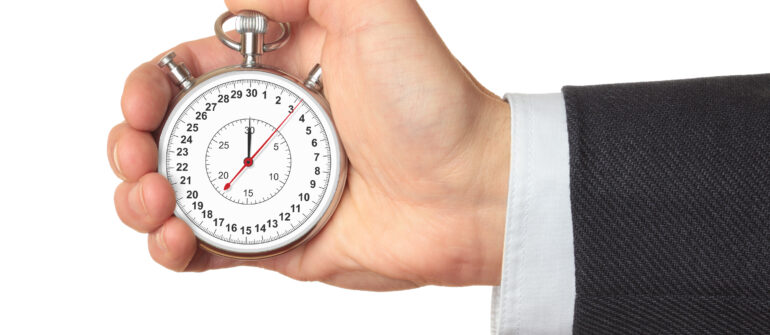 tracking indirect time in timesheet with indirect cost pools- man's hand in suit sleeve with stopwatch